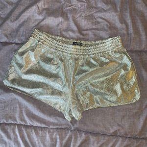 Express shiny silver short shorts with pockets!